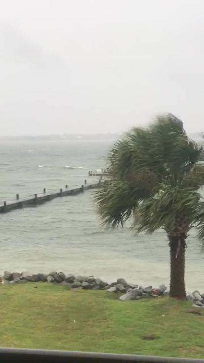 Video from Wednesday, Oct. 10, 2018 shows water rising over a deck on the soundside of Pensacola Beach around 7 a.m.