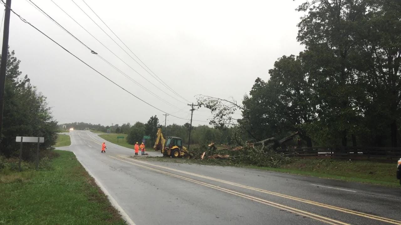 Downed tree blocks the northbound lane of Fork Shoals Road near I-185/385 southern connector in Greenville on Thursday, Oct. 11, 2018, following heavy early morning rain caused by Tropical Storm Michael.