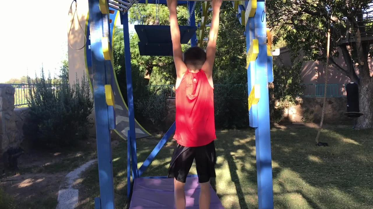 """""""American Ninja Warrior Junior"""" contestant Miles Odom, 10, trains on his backyard obstacle course."""