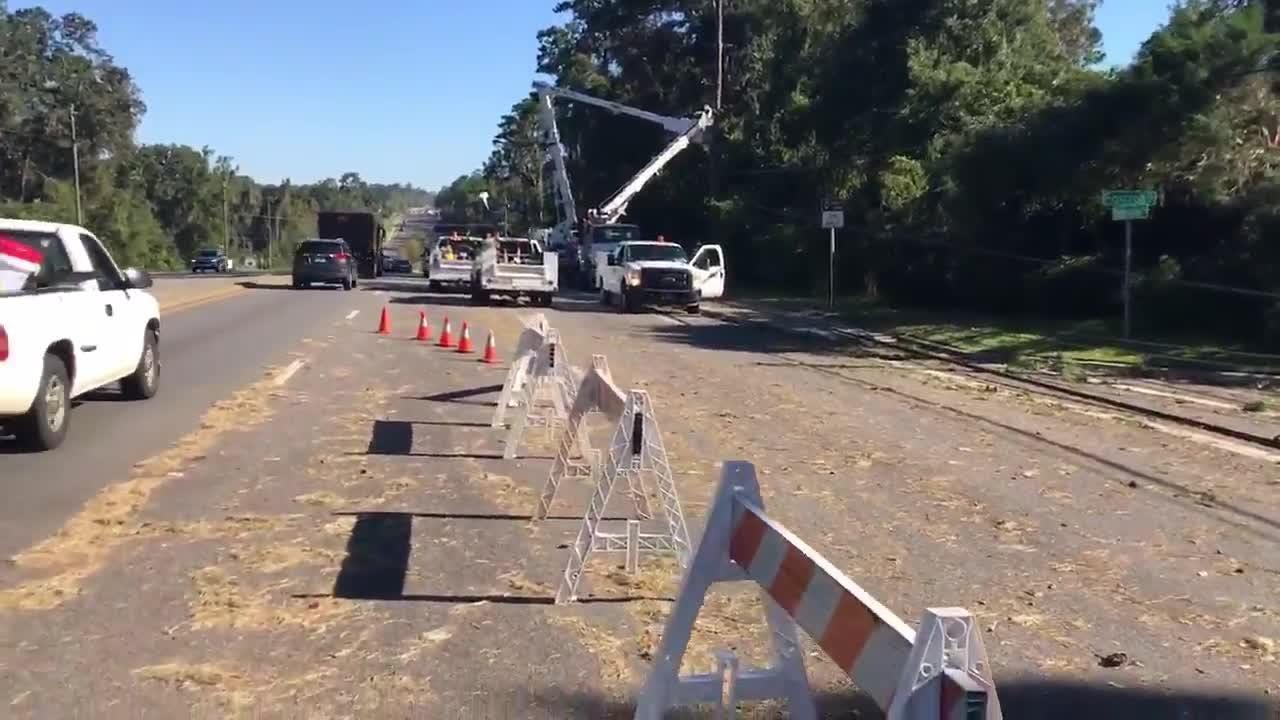 Reporter Jeff Schweers caught line crews repairing damage to about a dozen power poles on Thomasville Road near Foxcroft.