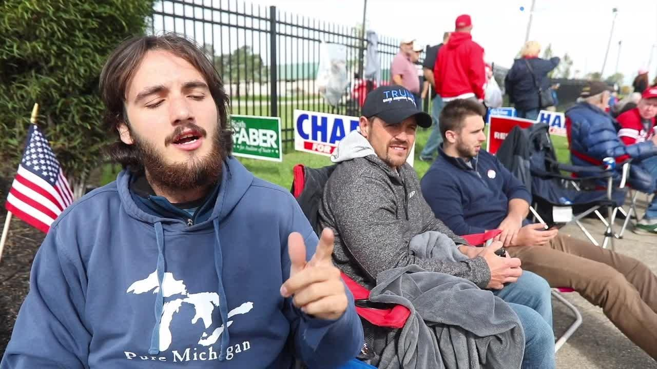 Brendan Gutenschwager, of Michigan, raps to the tune of Cardi B while waiting in line to see President Trump.