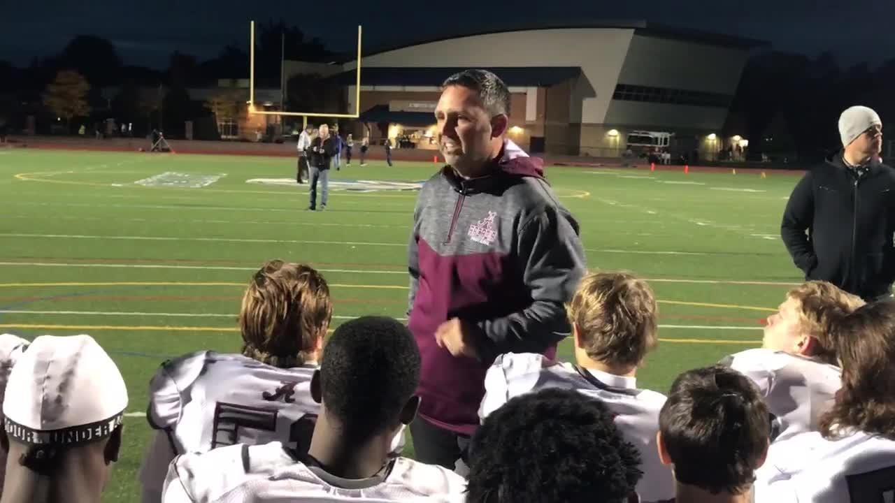 Arcadia coach Tony Streb fires up his Titans.