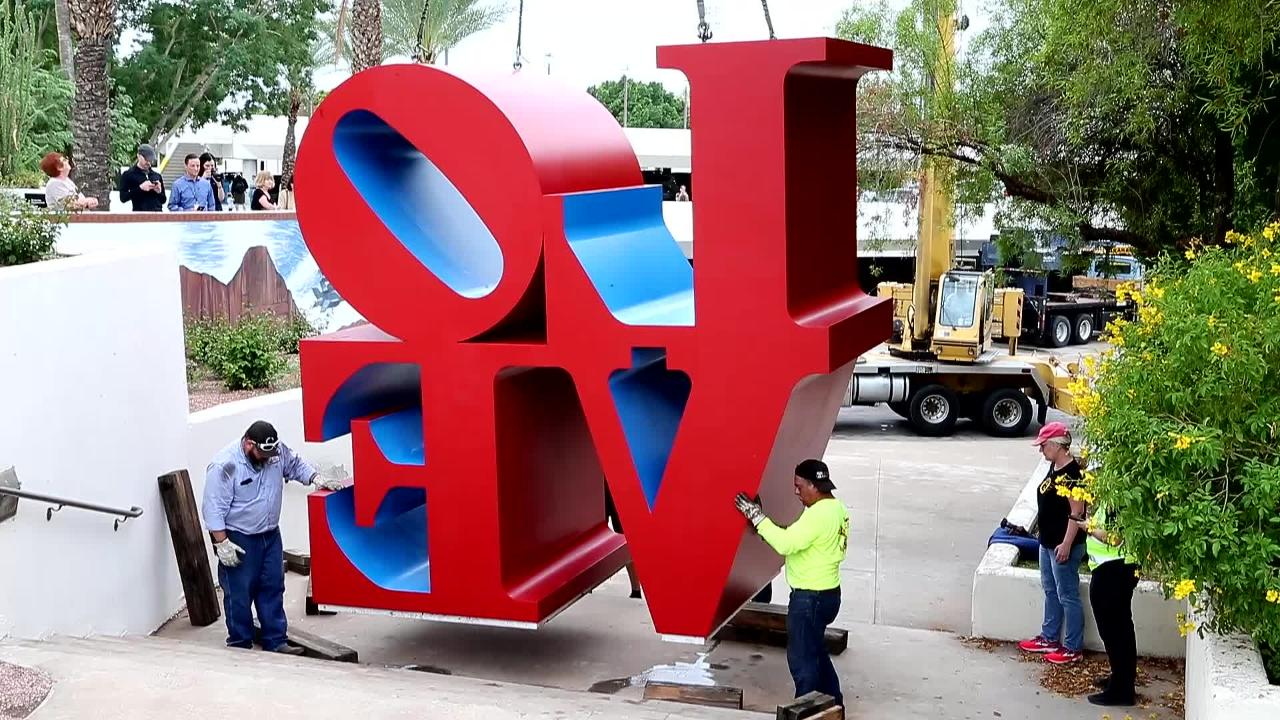 """The """"Love"""" sculpture in front of the Scottsdale Center for the Arts was moved Friday by a large crane."""