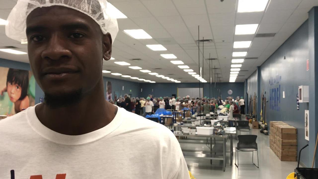 Phoenix Suns forward Josh Jackson volunteers at Feed My Starving Children Friday evening.