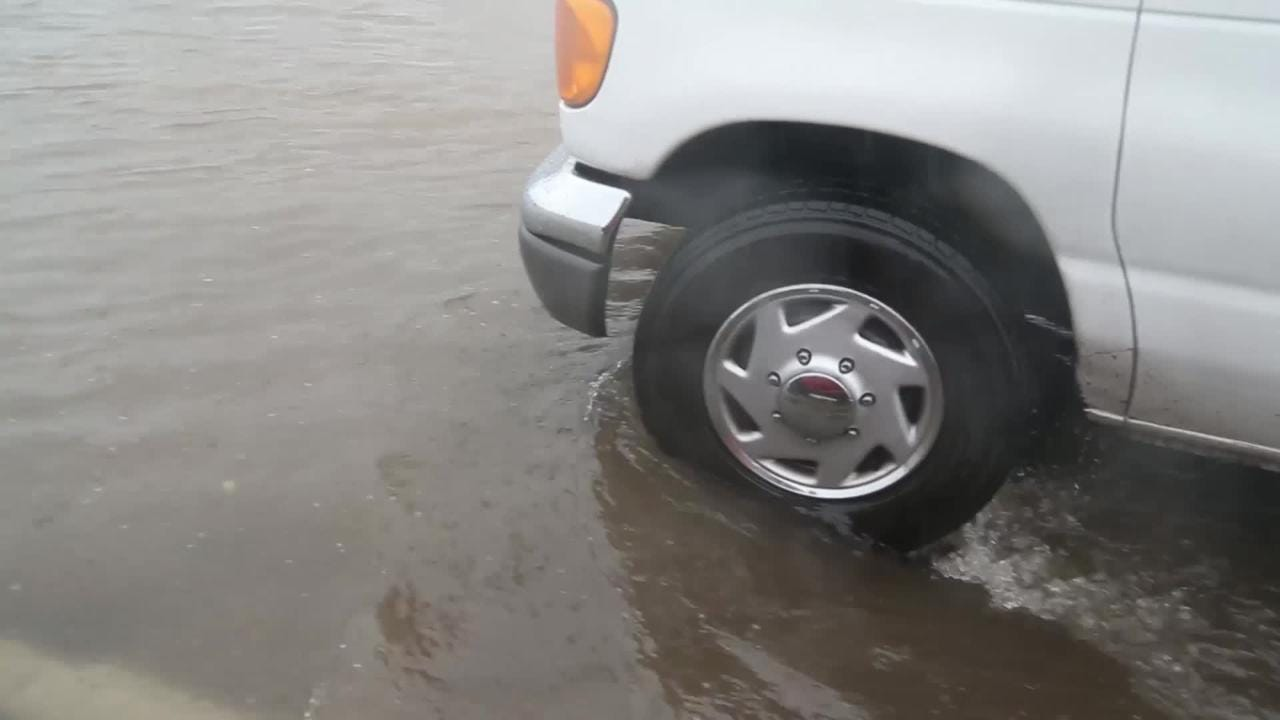 Streets fill with water as Phoenix is hit hard with rain on Saturday.