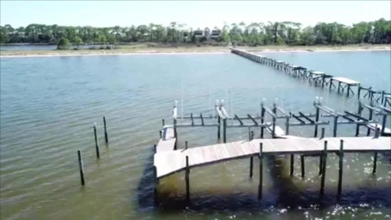 The damage done to a dock at Mariner's Harbor, a gated community, approximately 1 mile west of St. George Island State Park at Rattlesnake Cove.