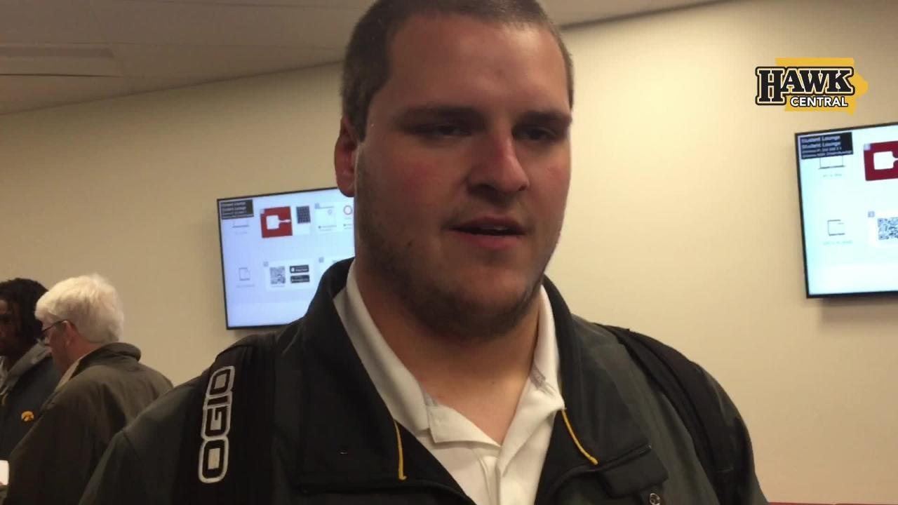 Iowa center Keegan Render embraces the attack