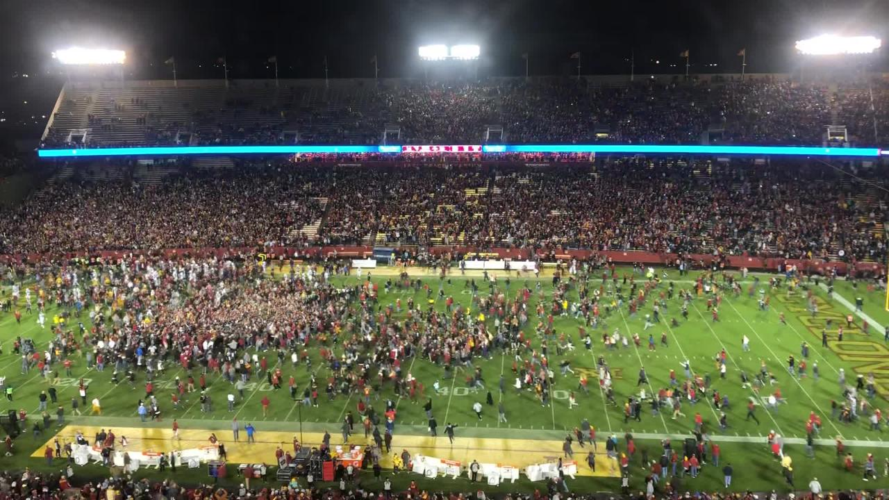 After Iowa State's win against ranked West Virginia, fan run on to the field, on Saturday, Oct. 13, 2018, in Ames.