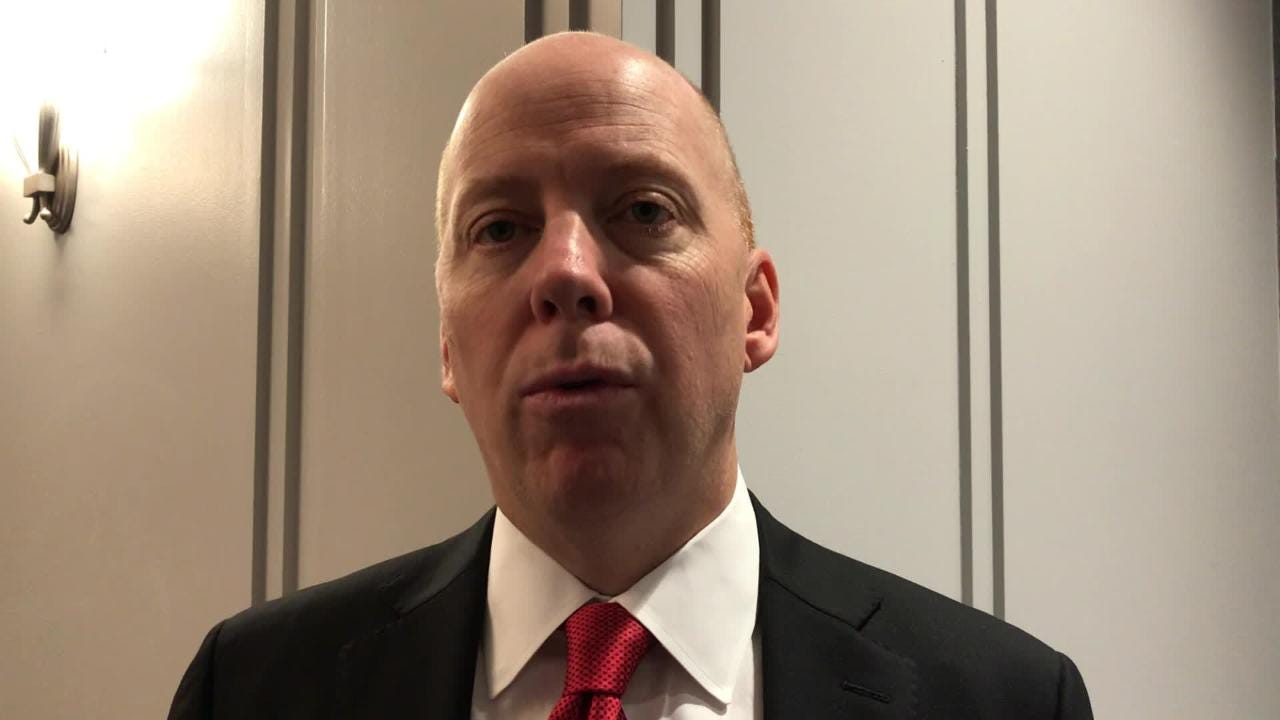 University of Cincinnati basketball coach Mick Cronin reacts to his team being picked 2nd in the preseason AAC coaches poll.