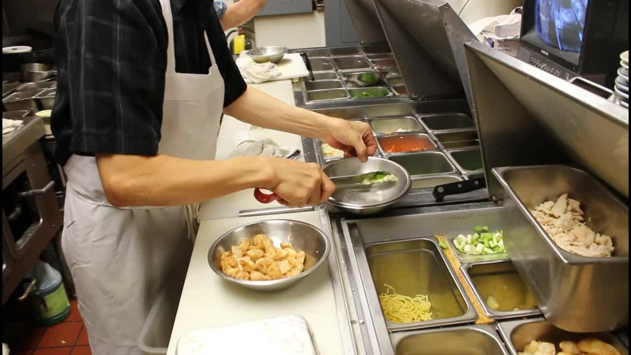 Chefs at Mark Pi's prepare the Island Wok and other dishes.