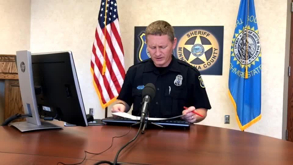 Police spokesman Sam Clemens goes over the call log on Monday.