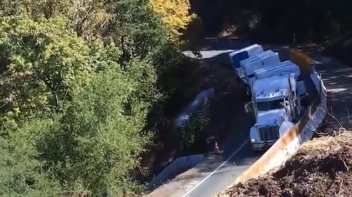 Watch and cringe as a big rig snakes around a narrow curve and falls off the road near Lakeport, Calif., near Sacramento. The driver was not injured, according to Caltrans.  It happened Oct. 11 on State Route 175. Caltrans edited the audio to remove expletives.