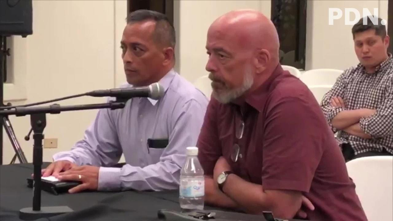 Attorney Tom Fisher addresses the Guam Election Commission on Tuesday night. Seated beside him is Sen. Frank Aguon Jr., who also addressed members of the commission.