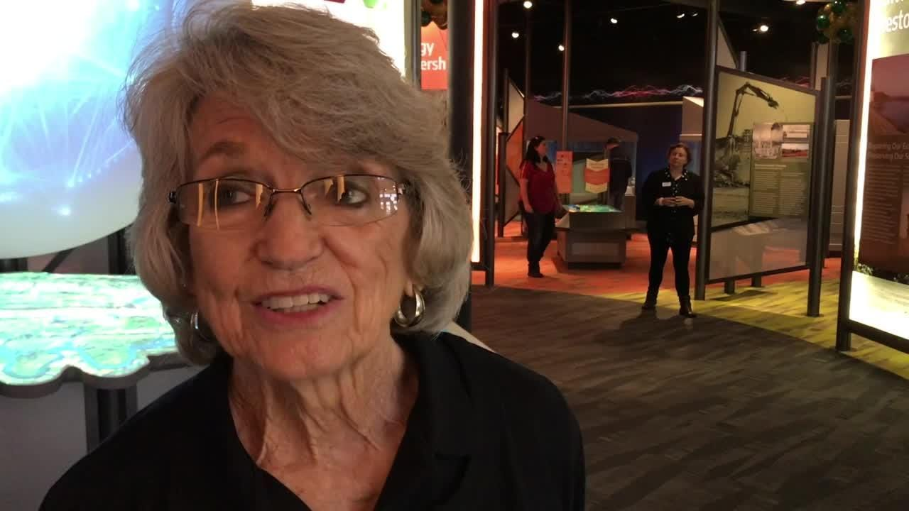 Educator Pat Fitchpatrick explains new exhibits at the new American Museum of Science and Energy