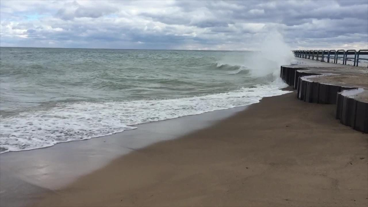 A wind from the north pushed large waves ashore in Port Sanilac