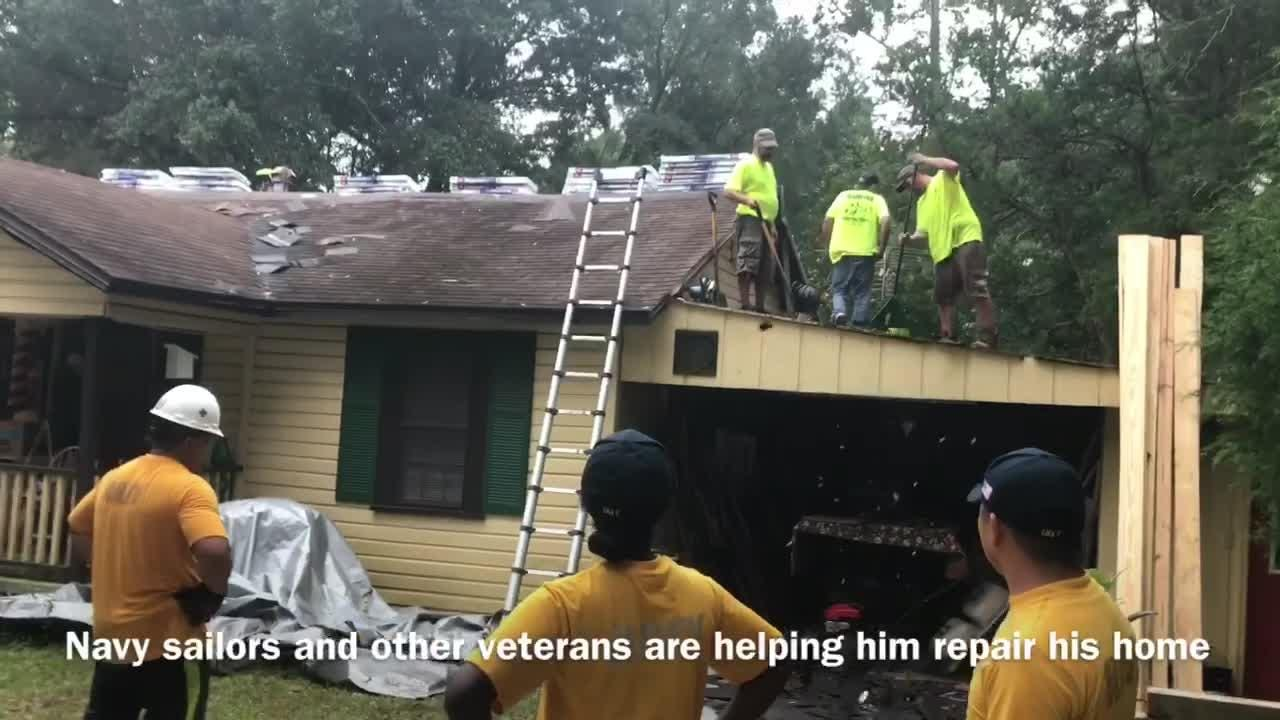 Volunteers from several groups worked Wednesday to repair the home of a beloved Pensacola veteran.