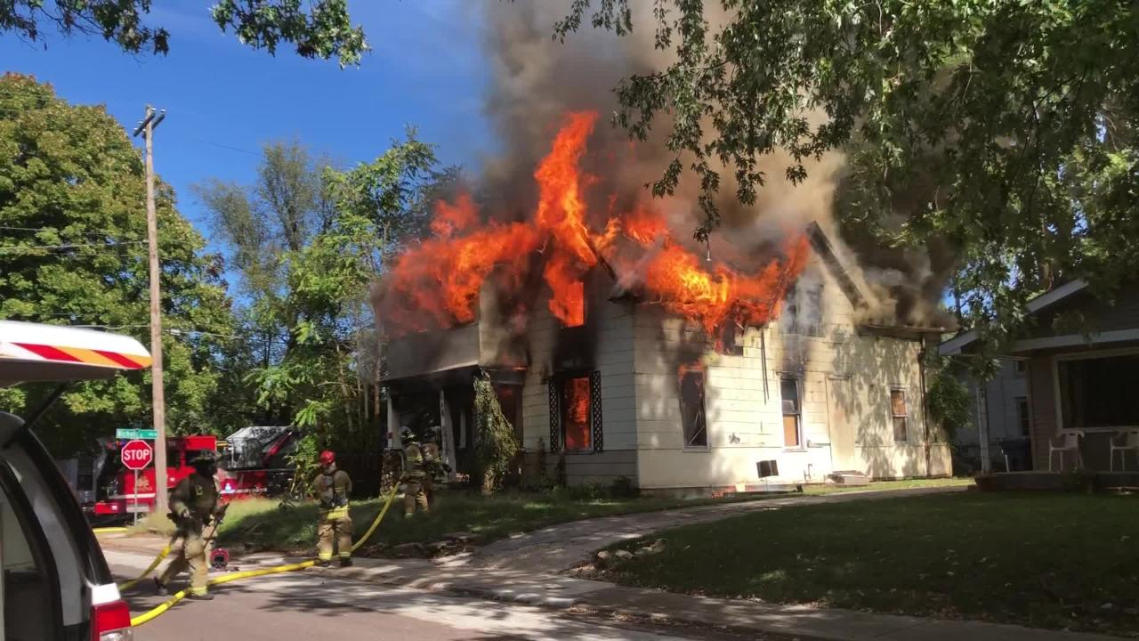 Firefighters on the scene of a house fire Wednesday at Nichols and Douglas.
