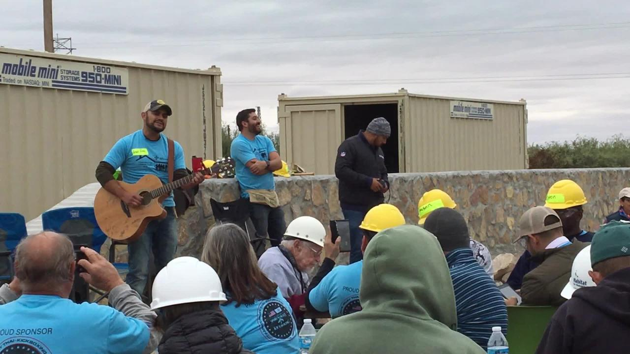 Frank Ray entertains Habitat for Humanity Volunteers at the home build site on Aurora Star Court, Wednesday October 17, 2018.