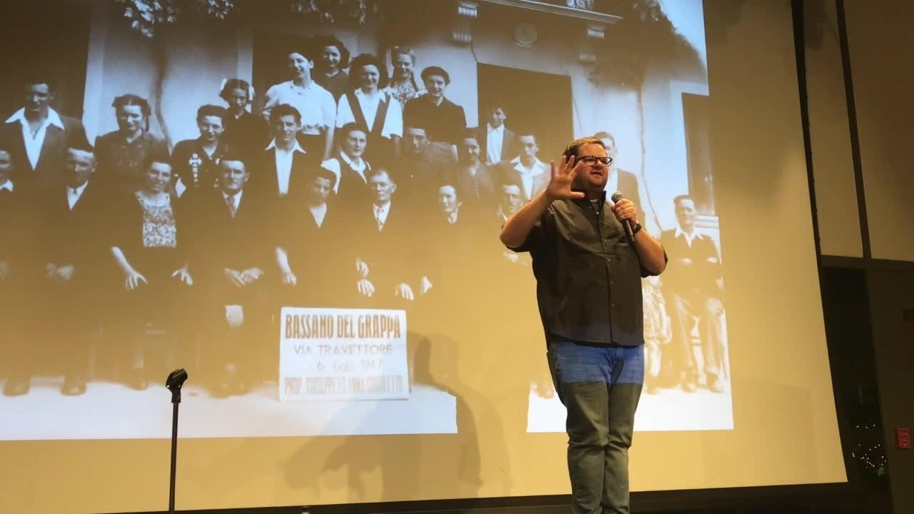 "Asbury Park Press journalist Mike Davis tells of his family's audacious trip to find their long-lost Italian family using nothing but an old photograph during the ""Home"" edition of the Jersey Storytellers Project on Oct. 17, 2018."