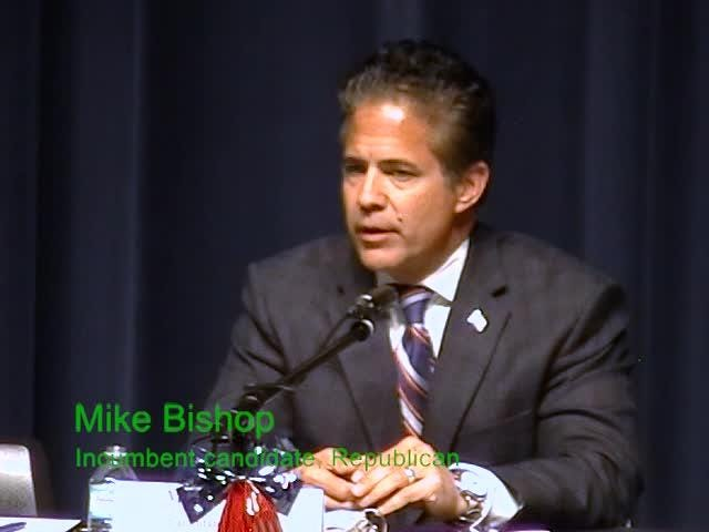 Congressman Mike Bishop and challenger Elissa Slotkin voice their differences on holding town hall meetings at a candidates forum.