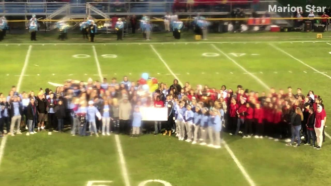 Students from River Valley and Harding gathered before the game to honor Logan Stevens, a student at both schools who died in a traffic accident.