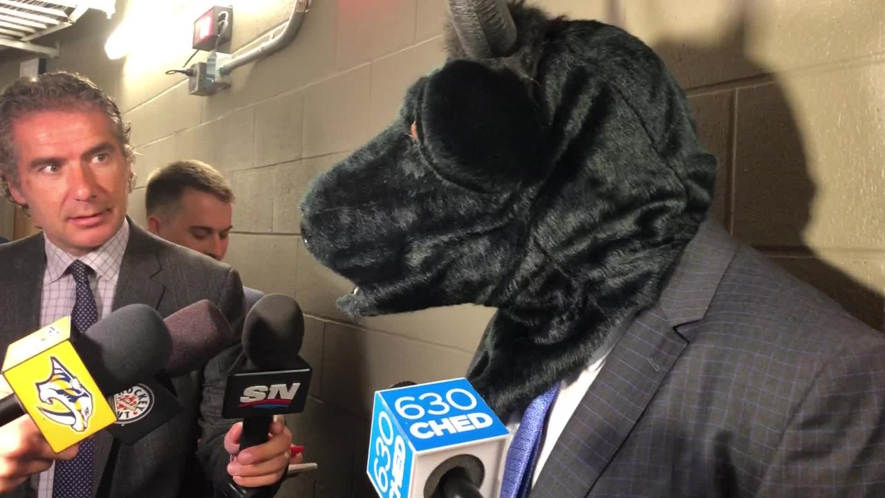 Predators coach Peter Laviolette wore a black bull mask to hold up his end of the bargain after his team won fifth straight