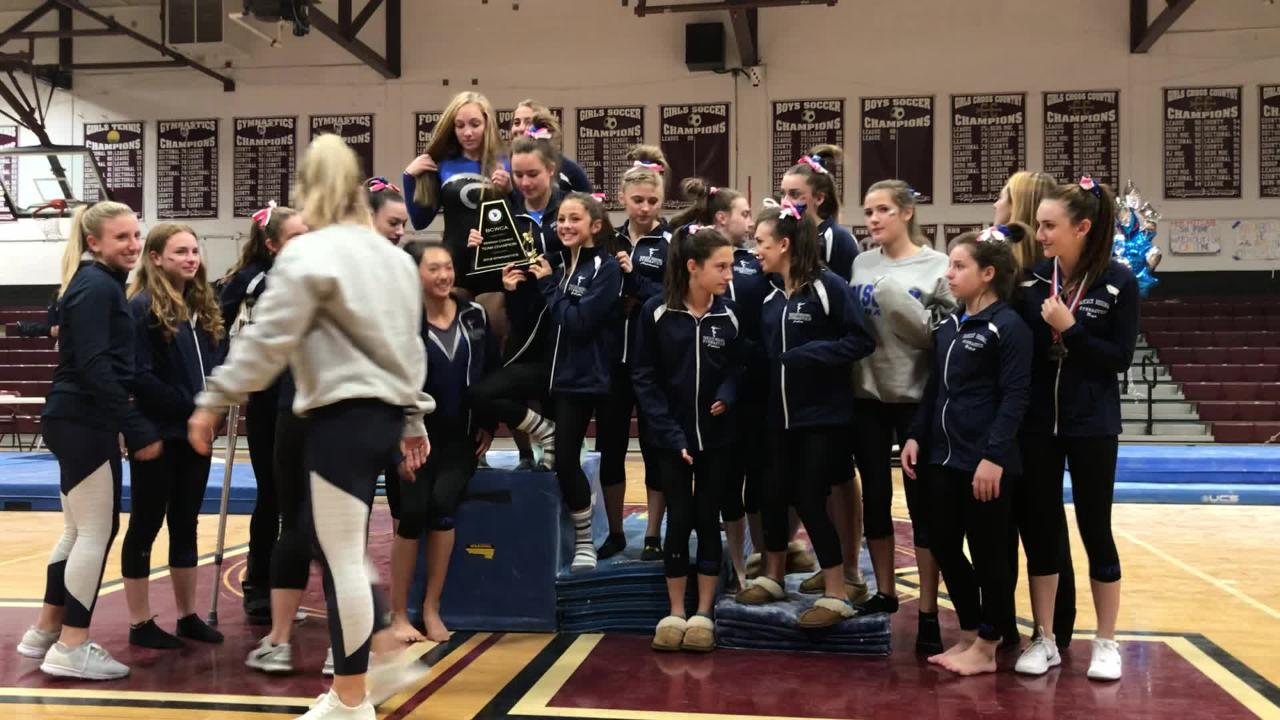 Pascack Regional collects the trophy after being announced as the Bergen County gymnastics team champion on Friday, Oct. 19, 2018 in Ridgewood.