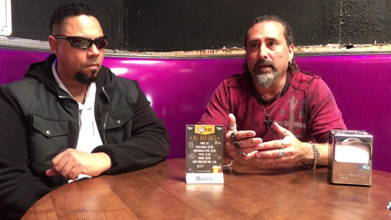 Fred Barnes, at right, discusses the decision to allow some controversial bands to perform at Dingbatz in Clifton.