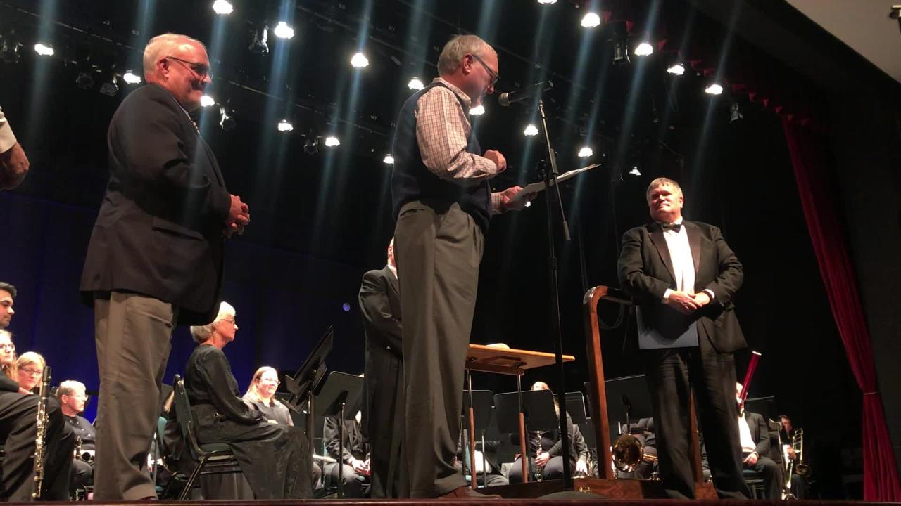 Newark Commissioner Tim Bubb presents surprise proclamation to Doug Moran for his hard work and service to the musical community of Licking County.