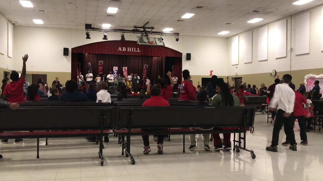 A.B. Hill Elementary school students celebrated school success with officials from the Shelby County School Board of Education.