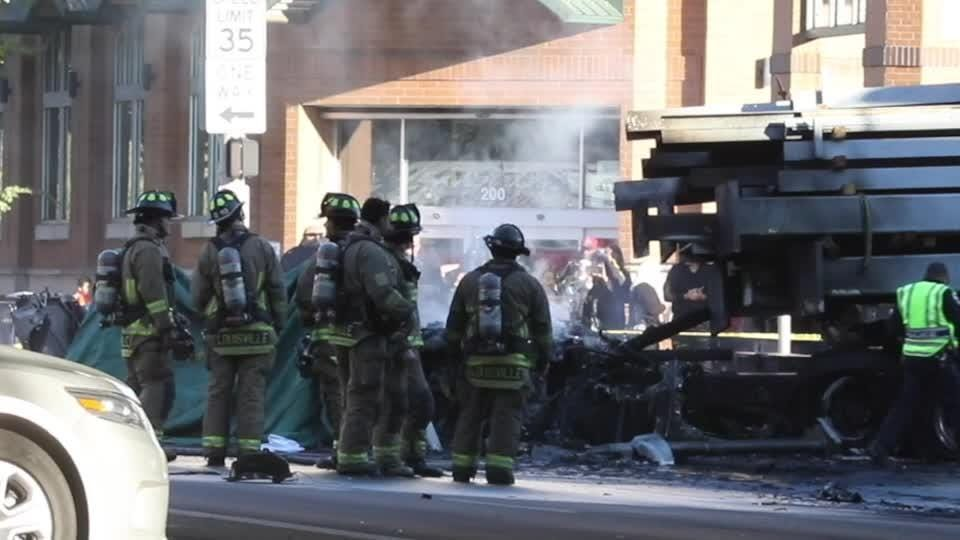 Smoke covers Broadway after a semi catches fire.