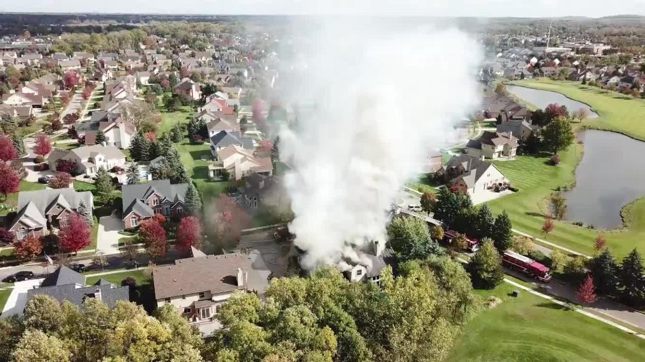 Smoke billows out of a Glengarry home near Meridian Drive in Canton Township.