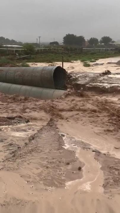 Las Crucen Shanon P. Windecker was driving in Picacho Hills with his parents when his father noticed this flooded arroyo. Windecker filmed the scene.