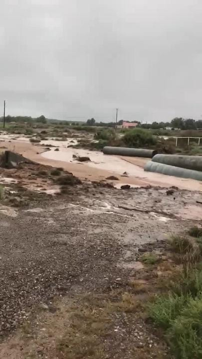 Shanon P. Windecker first filmed a flooded arroyo on Tuesday afternoon near Picacho Hills. He revisited the scene an hour later to note the difference