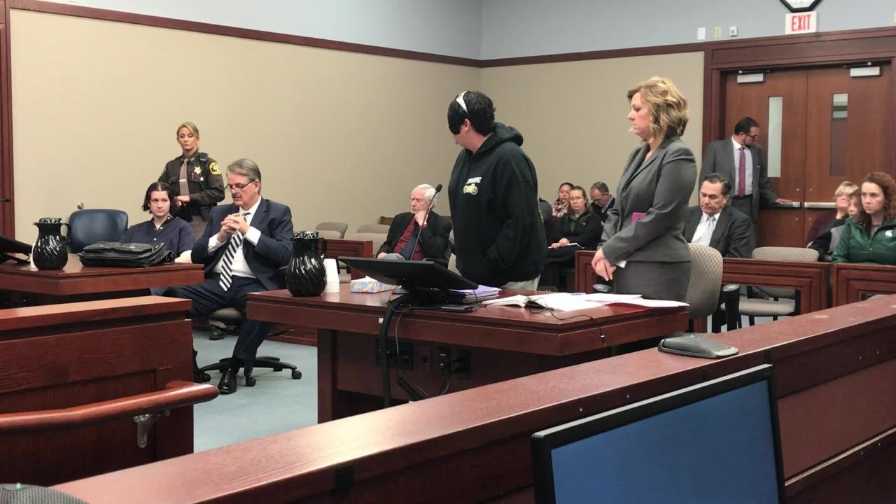 Tammy Hawkins (second from right) gives a victim impact statement in Ingham County Circuit Court at Brandon Addiss's murder sentencing hearing.