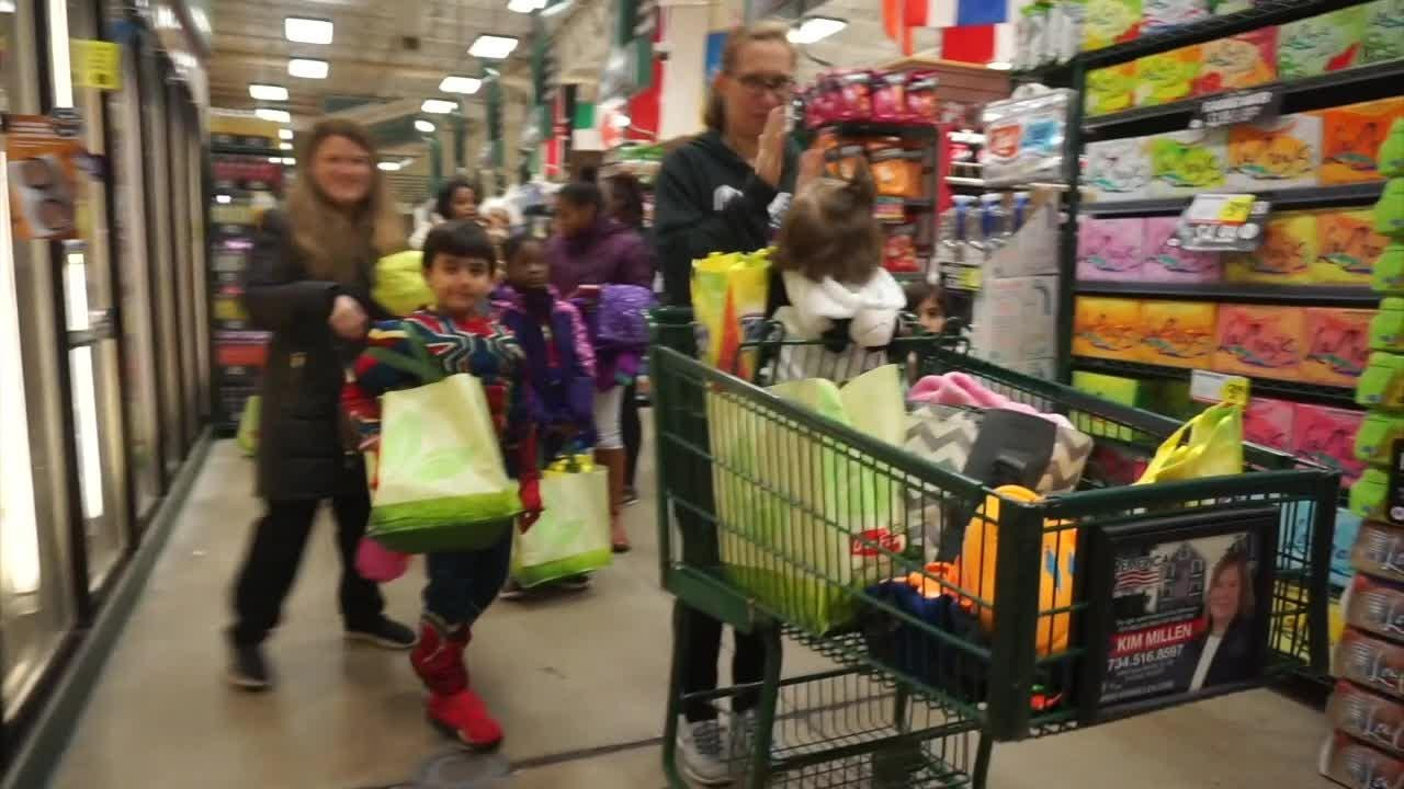 It's the annual Holiday Market Halloween celebration. Kids parade through the store and get all kinds of treats, some of them healthy, darn it.