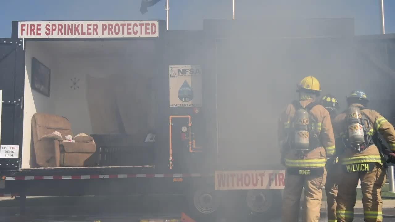 The Brighton Area Fire Department demonstrated the need for fire sprinklers by lighting two mock rooms on fire; one with sprinklers, one without.