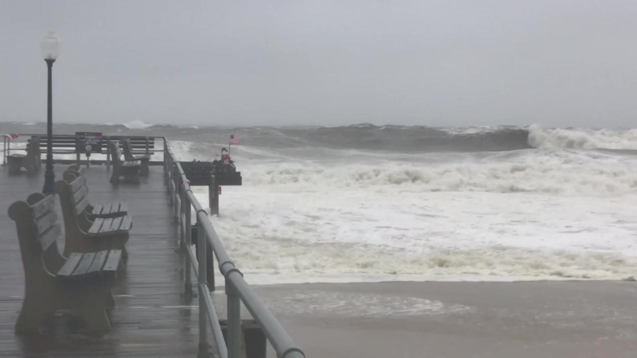 A strong nor'easter is generating 8- to 12-foot waves at the Jersey Shore. Waves pound the Ocean Grove Fishing Pier and its mascot, Ralph.