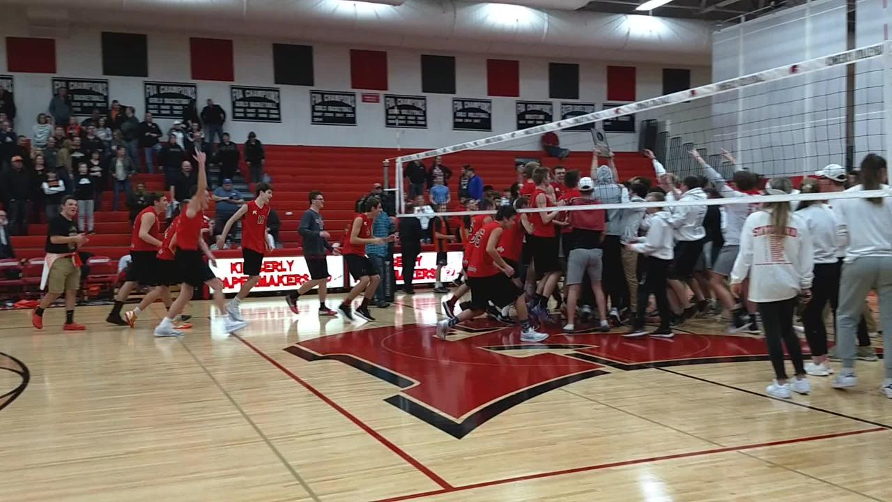 The Kimberly boys volleyball team celebrates its five-set victory over Kaukauna to win the sectional championship and advance to state.