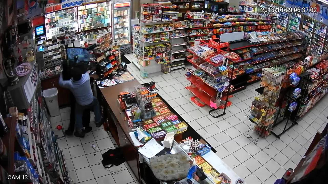 Watch as a clerk at a Port Huron gas station thwarts an unarmed robbery attempt by a masked bandit.