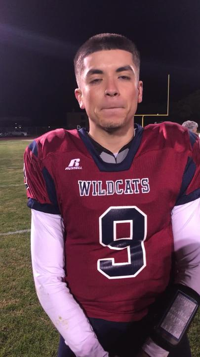 Senior Wildcat quarterback Daniel Garcia revels in Deming High's 49-35 victory over Silver High.