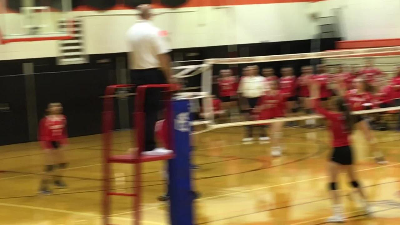 Red Hook can't get Owego's Kaylee Kelly's serve into play during Tuesday's Class B state playoff game at Union-Endicott.
