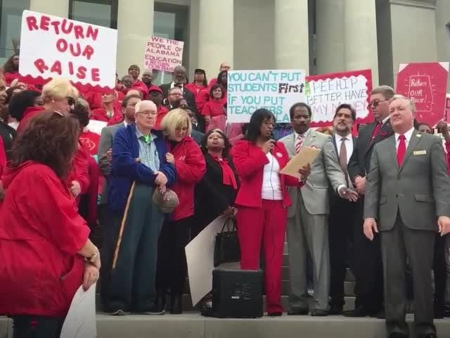 President Sherry Tucker addresses those at the Alabama Judicial Building in Montgomery on Wednesday, Nov. 7 to protest a health insurance premium increase.