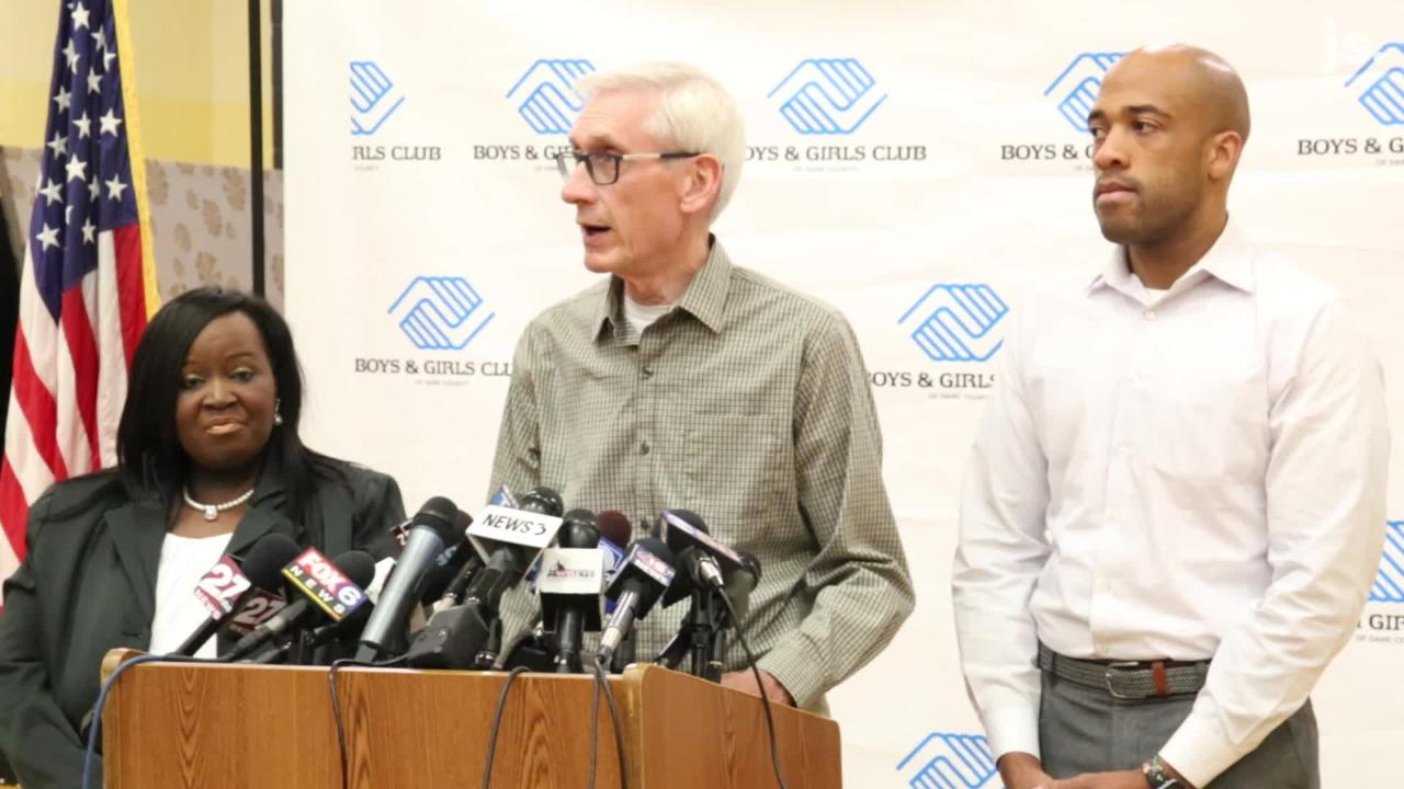 Governor-elect Tony Evers speaks with Lt. Gov.-elect Mandela Barnes and state Rep-elect Shelia Stubbs at the Boys & Girls Club in Madison.