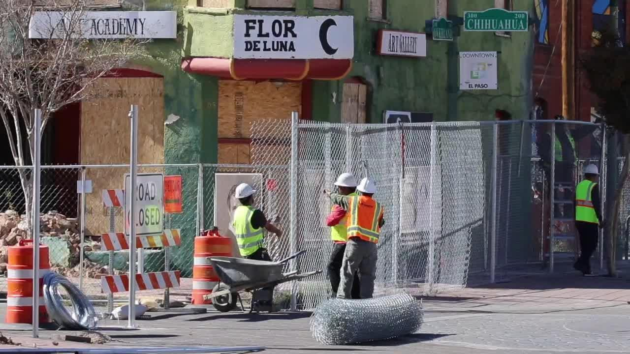 Over 60 El Paso police officers guarded crews fencing Duranguito Downtown arena site early Wednesday morning.