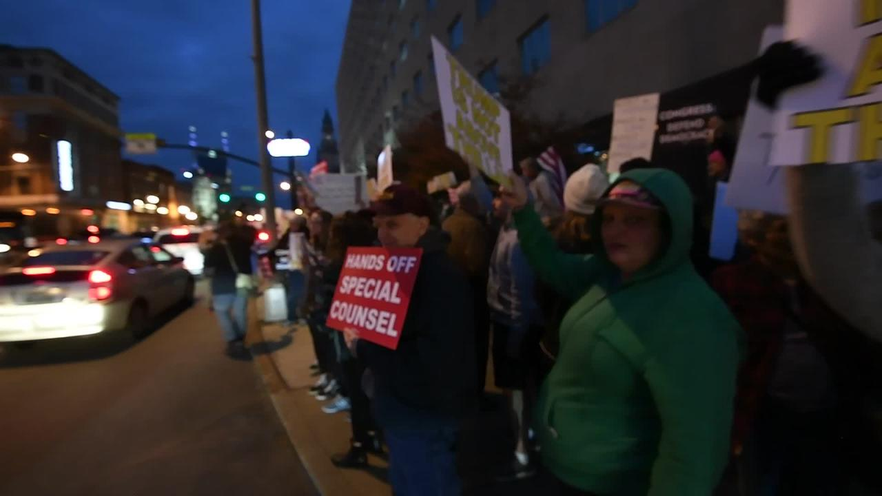 """Protesters gathered Thursday afternoon for a """"Nobody is Above the Law Rally"""" on Broadway in Nashville."""