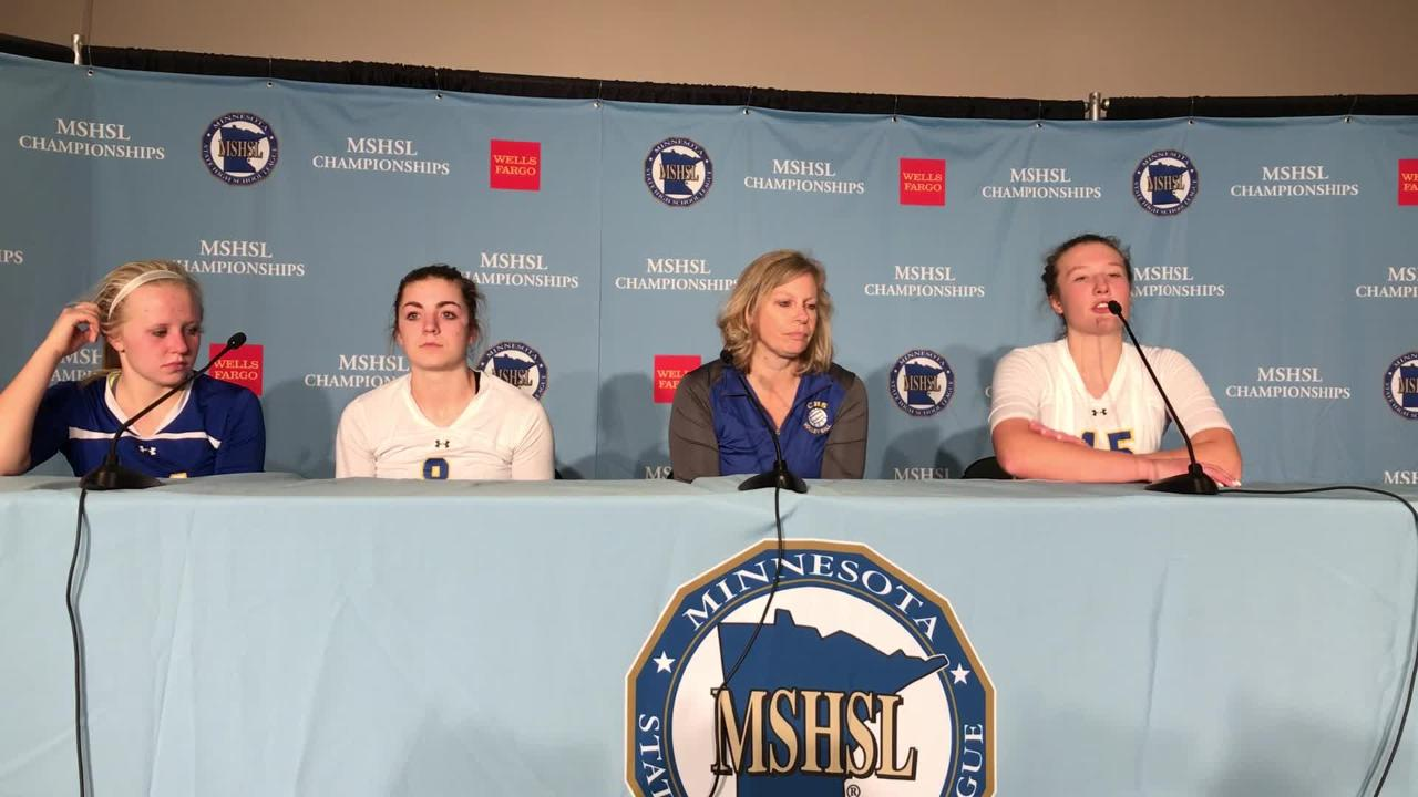 St. Cloud Cathedral's (from left) Abbey Medelberg, Megan Voit, Glenda Prom and Gabby Heying talk about Thursday's quarterfinal match. CHS lost, 3-0.