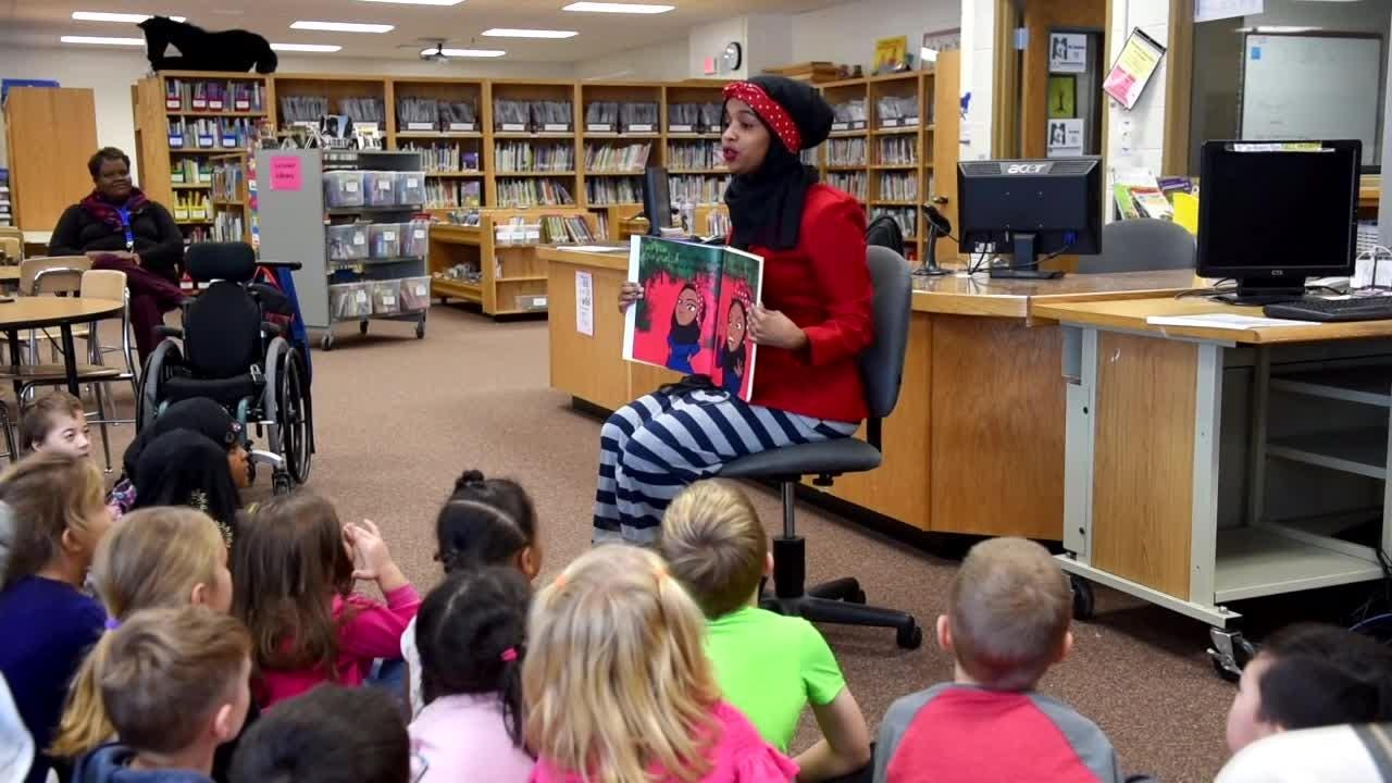 """Habso Mohamud reads her book called """"It Only Takes One Yes"""" to students at Madison Elementary School."""