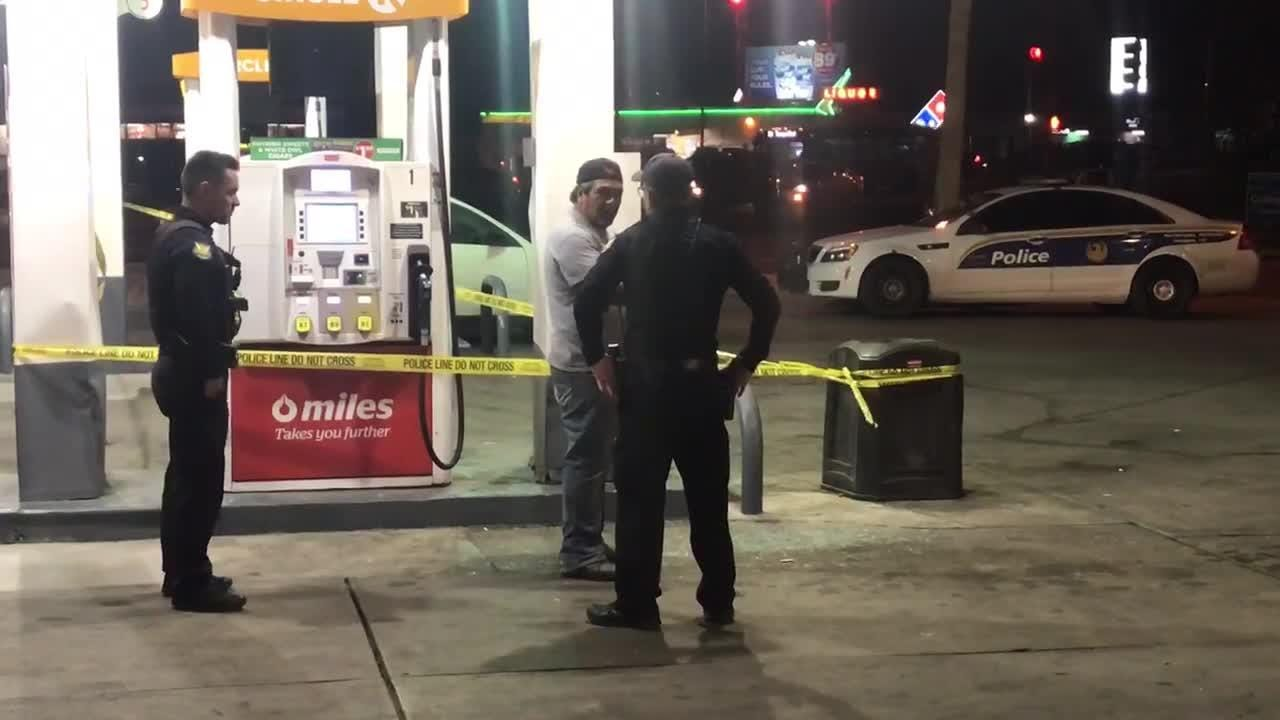 A victim of a carjacking talks with Phoenix police.