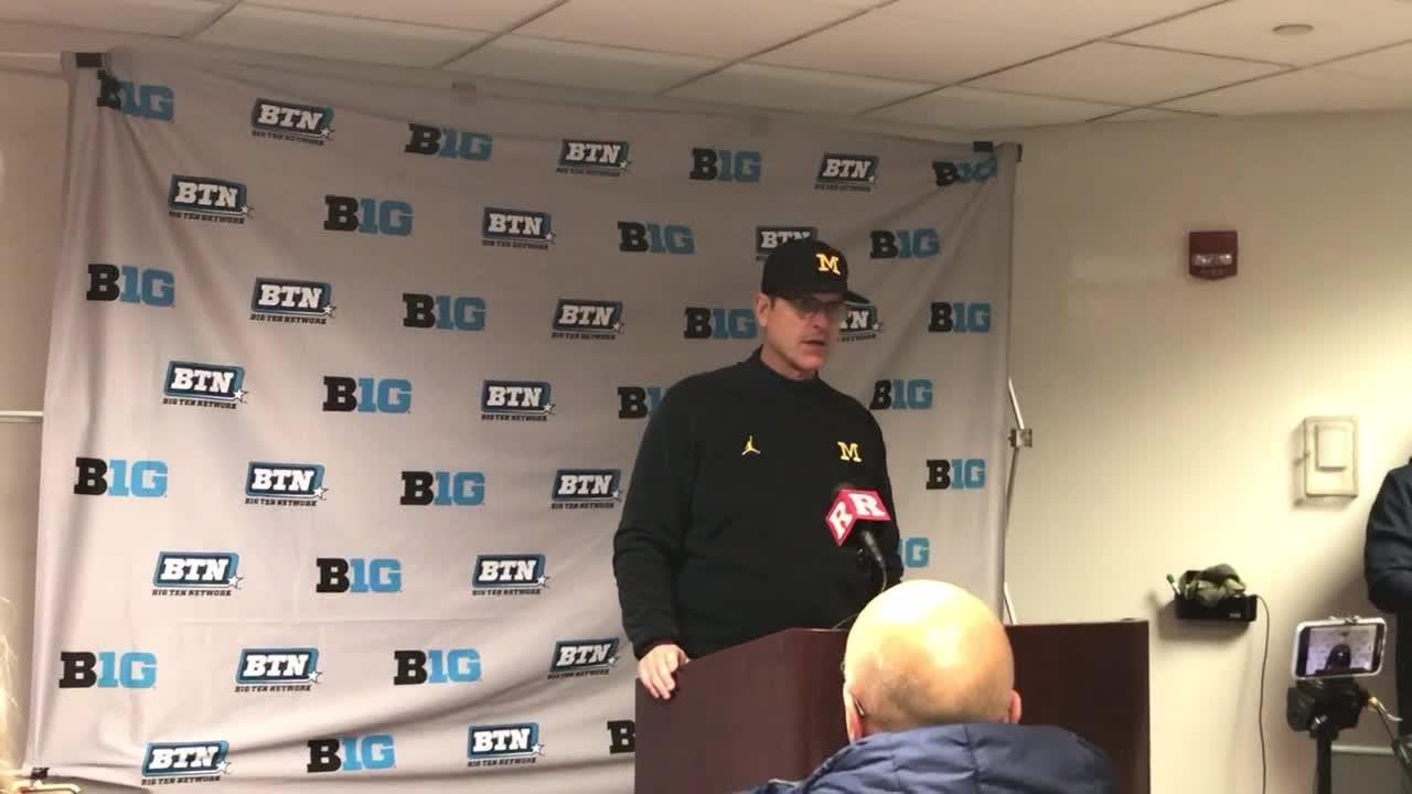 Michigan coach Jim Harbaugh praises QB Shea Patterson in 42-7 win over Rutgers, Nov. 10, 2018.